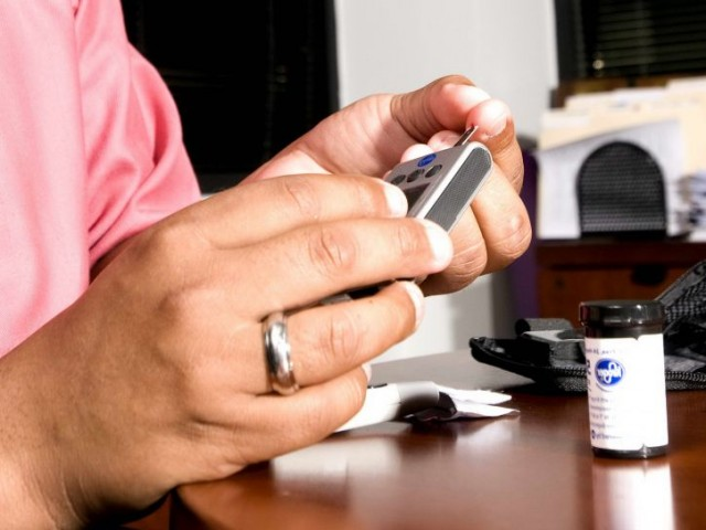 Photo: Testing Blood Sugar Levels - Asian Americans Not Being Screened for Diabetes
